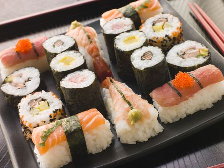 Selection of Seafood and Vegetable Sushi on a Tray with chopsticks photo