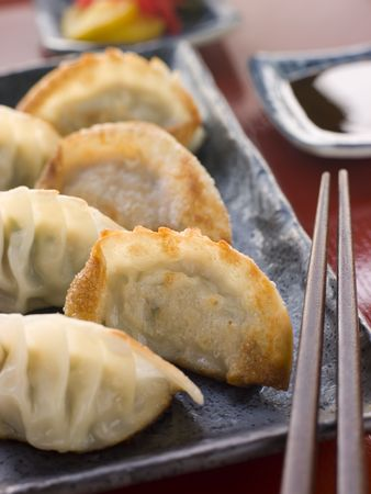 gyoza: Fried Pork and Shrimp Dumplings with Soy Sauce Stock Photo