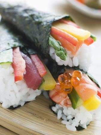 noone: Three hand Rolled Seafood and Vegetable Sushi