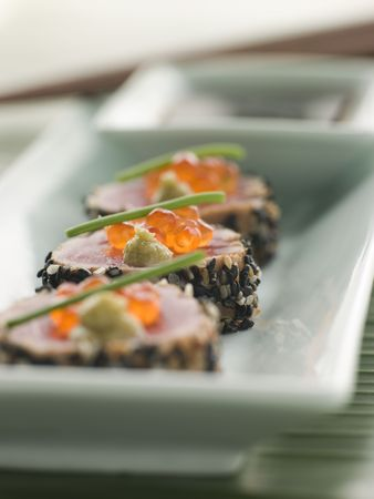 cutouts: Seared Yellow Fin Tuna Rolled in Sesame seeds with Wasabi and Salmon Roe