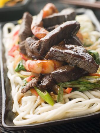 Teriyaki Beef Fillet and Tiger Prawns with Udon Noodles Stock Photo - 3131524