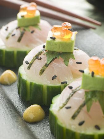 Sashimi Of Sea bass with Avocado and Salmon Roe Stock Photo - 3131432