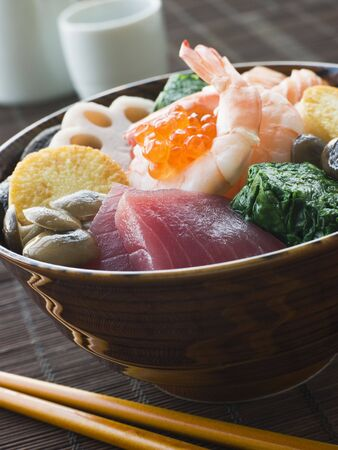 Sushi Rice Bowl with Tuna Salmon Prawn Tofu and Vegetables photo