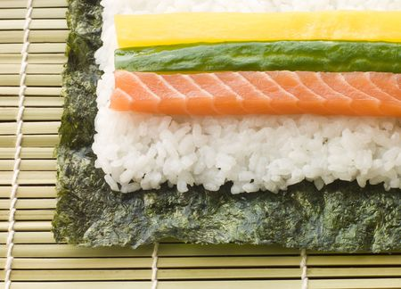 Making Rolled Sushi in a Sushi Mat Stock Photo - 3131654