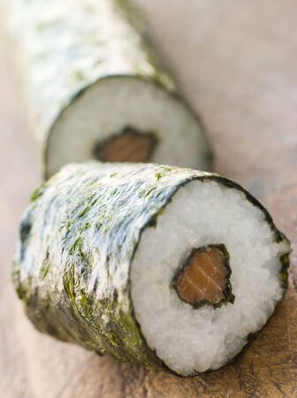 Roll of Salmon Sushi on a Board Stock Photo - 3131427