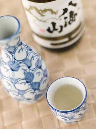 Sake Bottle Jug and Cup  photo