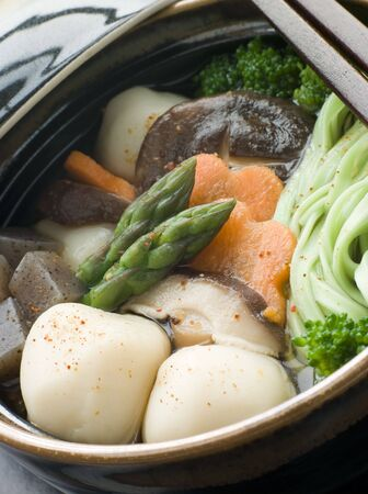 Fish Ball Stew Pot with Vegetables and Spinach Noodles Stock Photo - 3131560