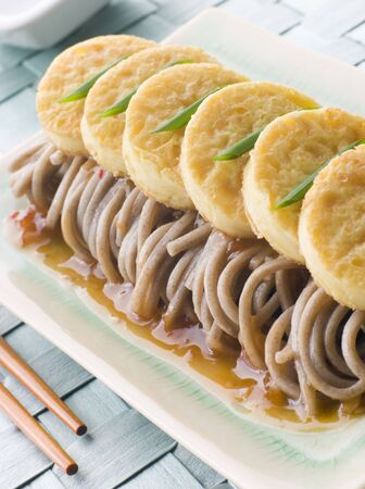 Fried Silken Tofu on Noodle Salad Stock Photo - 3131528
