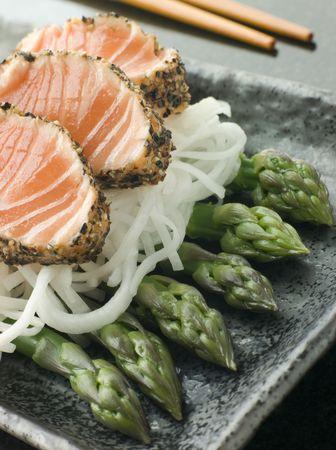 seared: Seared Salmon SashimiBlack Pepper with a Mouli and Asparagus Salad Stock Photo
