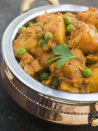 int: Curried Potatoes Peas and Cumin Stock Photo