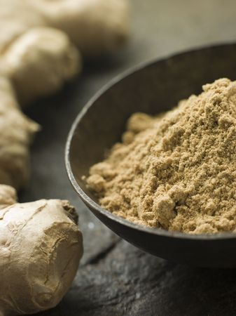fresh ginger: Dish of Ginger Powder with Fresh Ginger Root