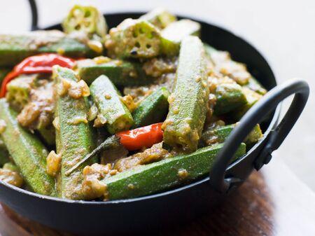 indian cookery: Karahi Dish with Bhindi Masala Stock Photo