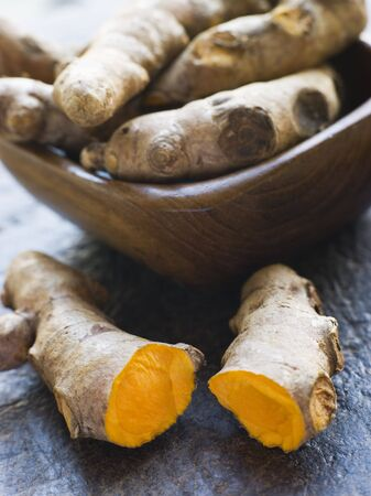 Pieces of Whole And Cracked Fresh Turmeric Root Stock Photo - 3131742