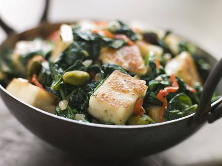 cutouts: Karai Dish with Spinach and fried Paneer