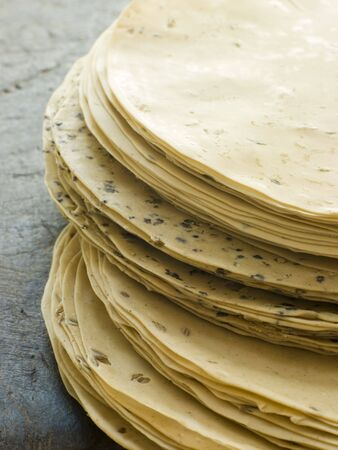 peo: Stack of uncooked Papadoms