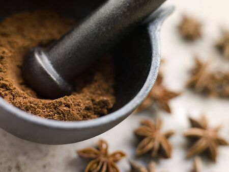 Ground Star Anise in a Pestle and Mortar photo