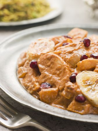Chicken Kashmiri on a Pewter Plate with Pilau Rice Stock Photo - 3132333