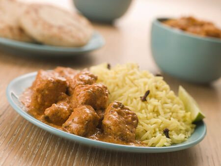 naan: Plated Chicken Korma with Pilau Rice and Naan bread