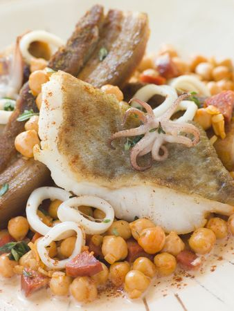braised: Pan Fried Cod Fillet and  Squid with Braised Belly Pork and Chick Peas Stock Photo
