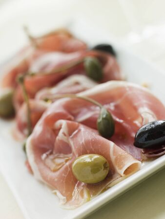 Serano Ham Olives and Caper Berries Stock Photo - 3135308