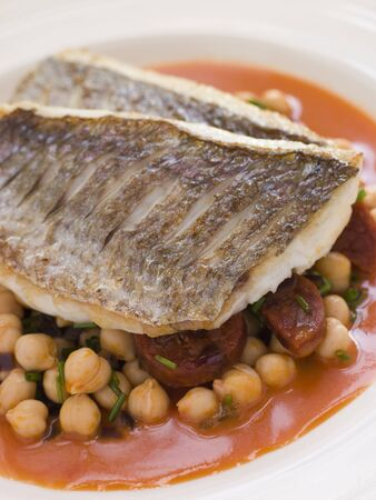 chorizos: Fillets of Sea Bream with Chorizo Sausage Chickpeas and Tomato Sauce Stock Photo