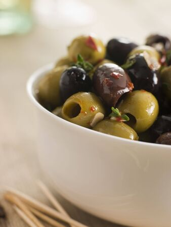 marinated: Bowl of Chilli and Garlic Marinated Olives Stock Photo