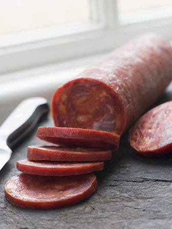 chorizo: Sliced Chorizo Sausage Stock Photo