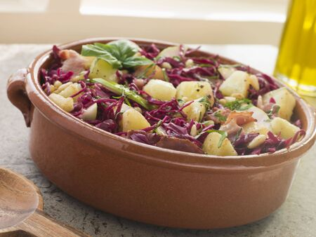 noone: Potato Bacon and Pickled Red Cabbage Salad Stock Photo