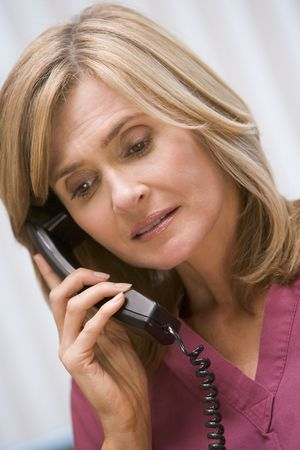colour images: Consultant phoning client with bad news