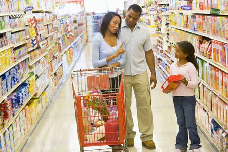 aisles: Mother and father with young daughter shopping at the grocery store.