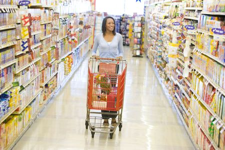 aisles: Woman shopping at a grocery store