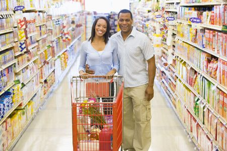aisles: Young couple shopping at a grocery store