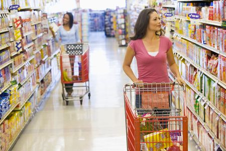 aisles: Two women shopping at a grocery store