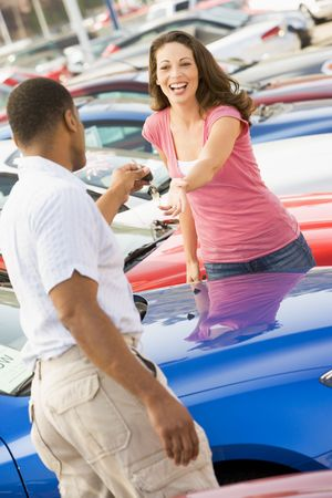 dealerships: Woman shopping for a new car