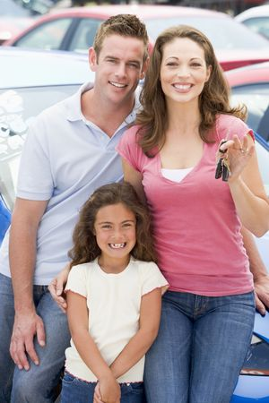 dealerships: Mother Father and young daughter shopping for a new car