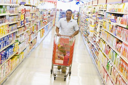 aisles: Man shopping at a grocery store