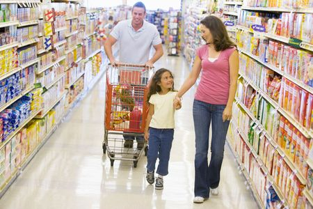 aisles: Mother and father with young daughter shopping for a new car