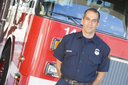 fourties: Fireman standing in front of fire engine Stock Photo