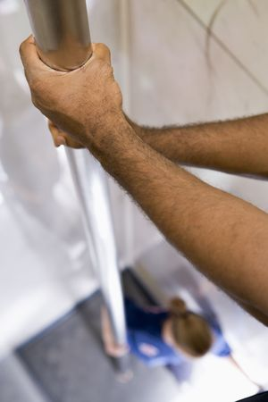 fourties: Shot of firemans hands on a fire pole with firewoman at bottom (selective focus) Stock Photo