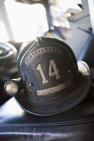 differential focus: Firefighting helmet in fire engine on seat (selective focus)