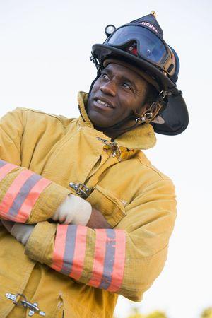 fourties: Fireman standing outdoors wearing helmet