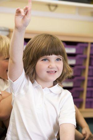 caucasian appearance: Student in class volunteering (selective focus)