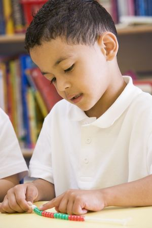 schoolmate: Student in class learning numbers (selective focus) Stock Photo
