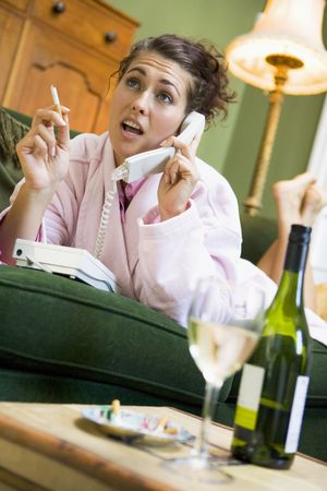 Young woman at home talking on telephone Stock Photo