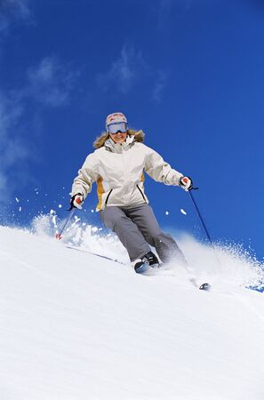 skiers: Skier coming down hill smiling Stock Photo