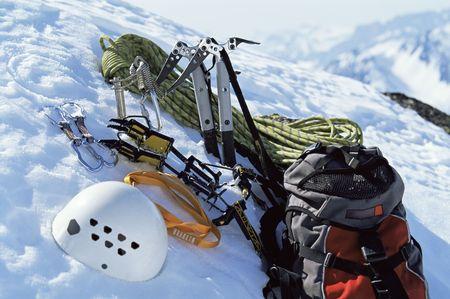 sporting activity: Mountain climbing equipment on a snowy mountain (selective focus)