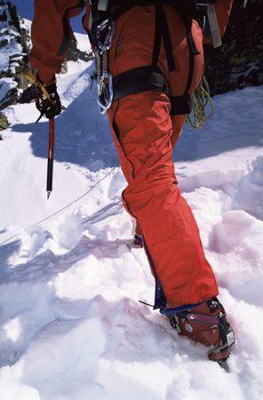 recreational climbing: Mountain climber going up snowy mountain (selective focus)