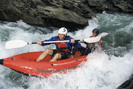 caucasoid race: Two kayakers in rapids smiling (selective focus) Stock Photo