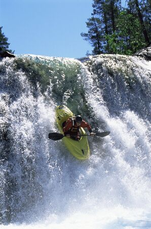 caucasoid race: Kayaker in rapids going over waterfall Stock Photo