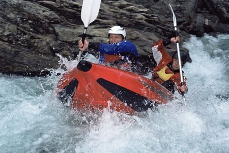 canoeist: Two kayakers rowing in rapids Stock Photo